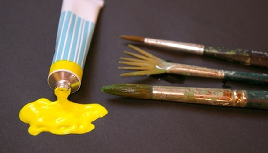 A tube of artist's paint and artist's brushes