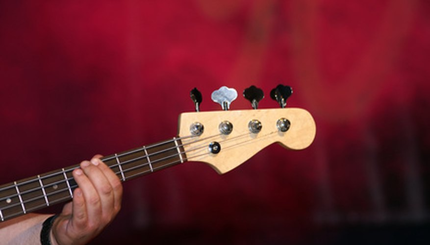 The nut on a bass or guitar helps keep the strings in place and at the proper height.