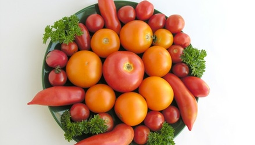 Enjoy many variety of tomatoes by using a Topsy Turvy container.