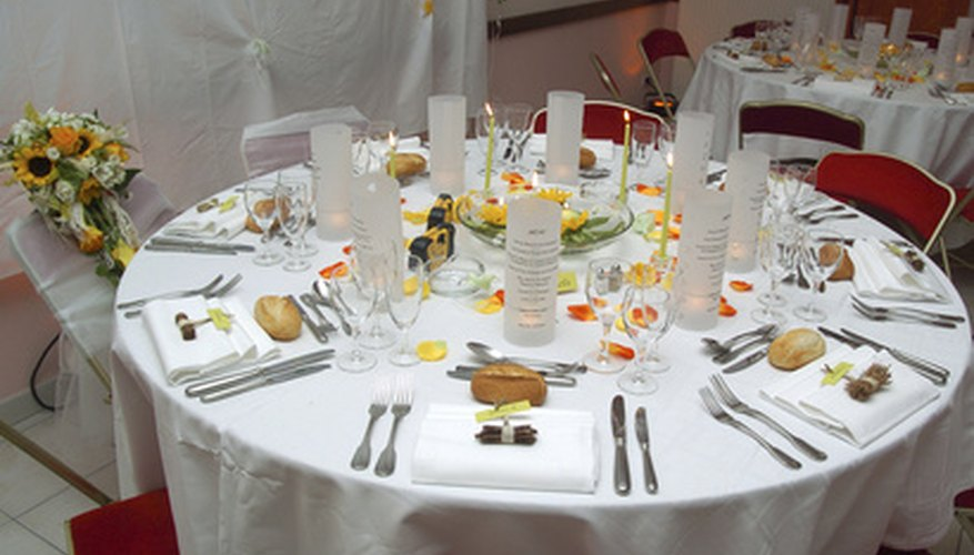 Individual candles surround a lighted floral centerpiece.