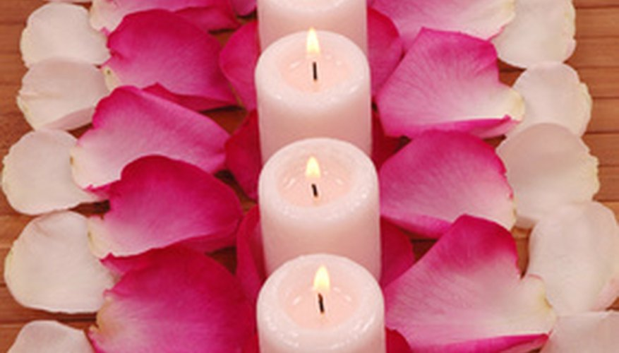 Form parallel rows of candles and rose petals for a romantic centerpiece.