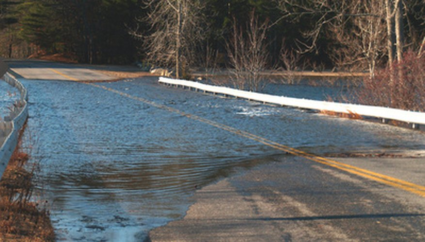 Floodwaters cover a road.