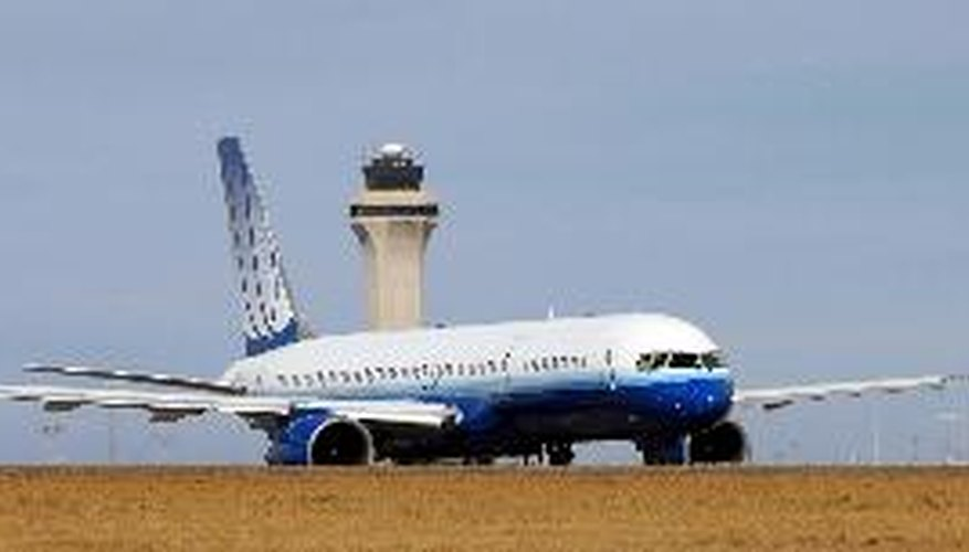 Side view of airplane on runway