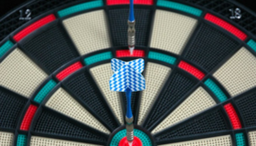 An electronic board features holes that the darts stick in when thrown.