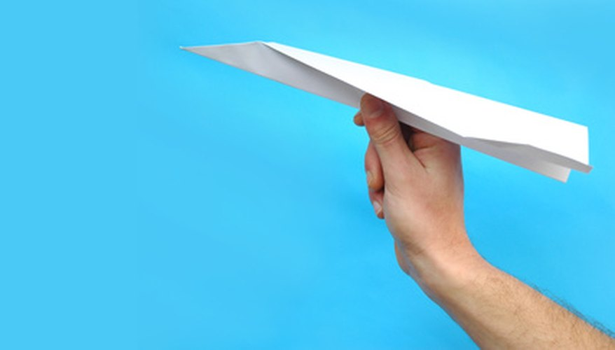 Improve the design of your paper airplane to achieve better flights.