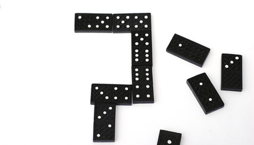 Same-suited dominoes are laid against eachother during play.
