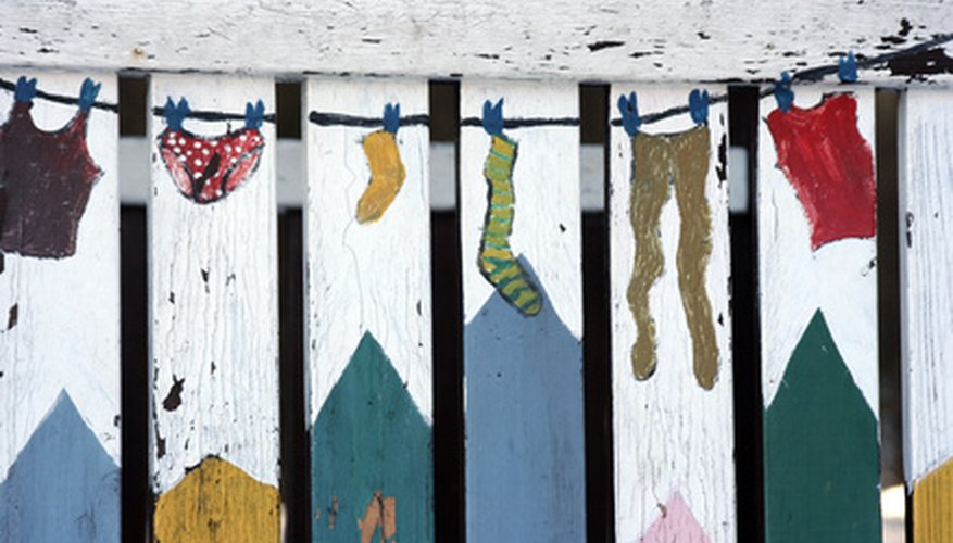 Folk art painting on a fence.