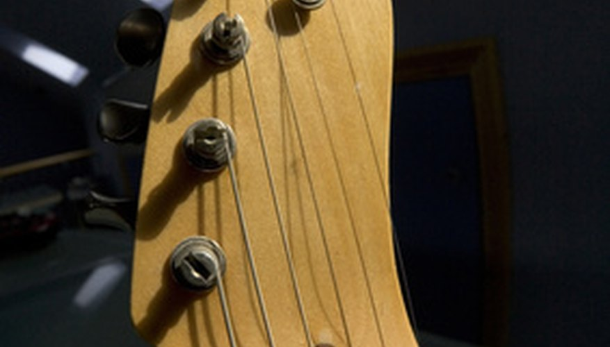 A guitar's make and model are usually found on the head.
