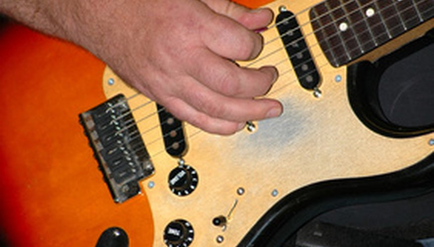 Use an electric guitar to play acoustic songs.