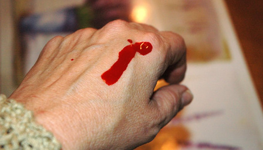 Fake blood oozing out of the stab wound will make the knife appear more real.