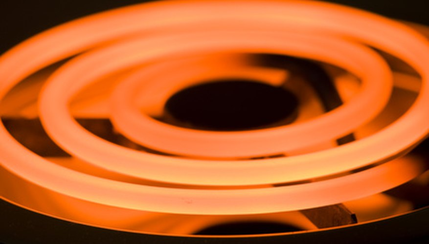 A glowing electric stove element heated by an internal nichrome wire.