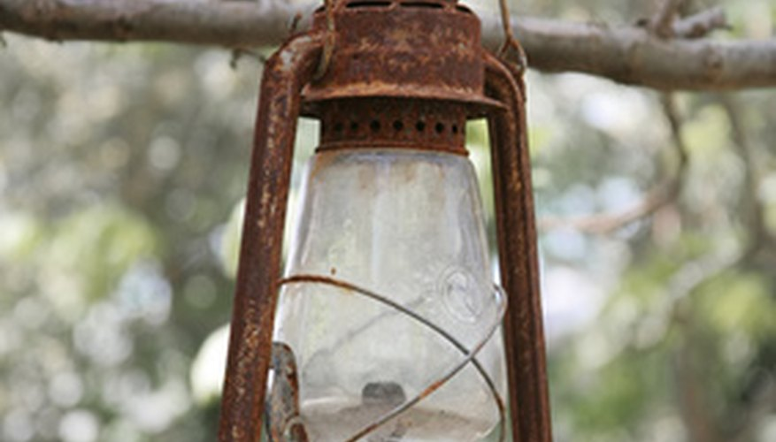 An old lantern is the base for a country style centerpiece.