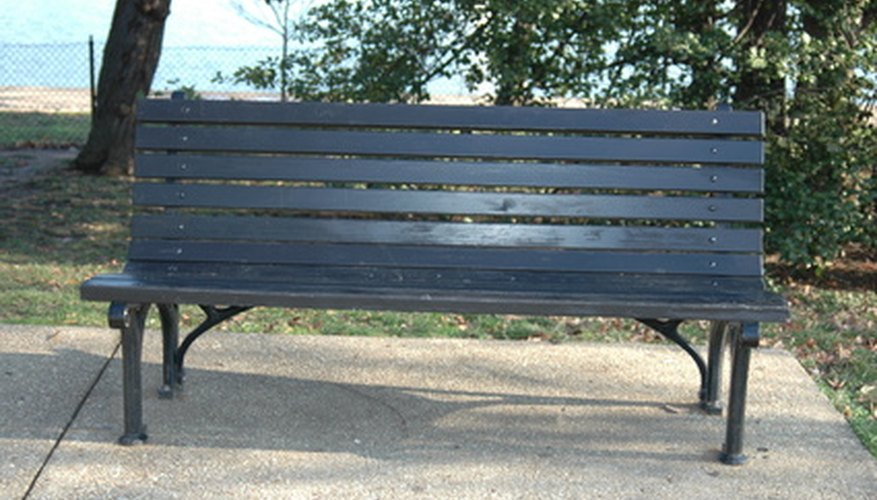 Painting a park bench may restore its original luster.