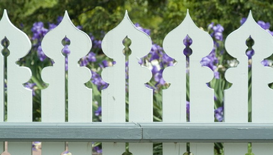 An Ornamental Fence Lends A Victorian Touch To The Garden.