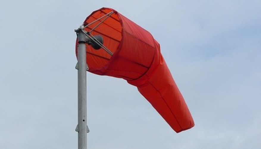 A wind sock raises from its resting position as the wind blows.