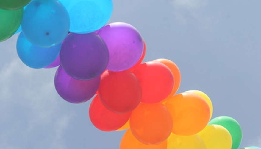 Fill colorful balloons with helium for party decorations.