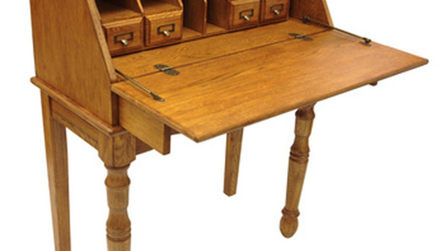 Antique secretary's desks originated in the 1600s as small traveling desks.