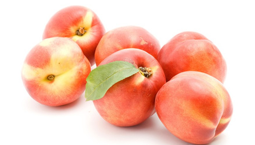 The donut peach looks different from other peaches.