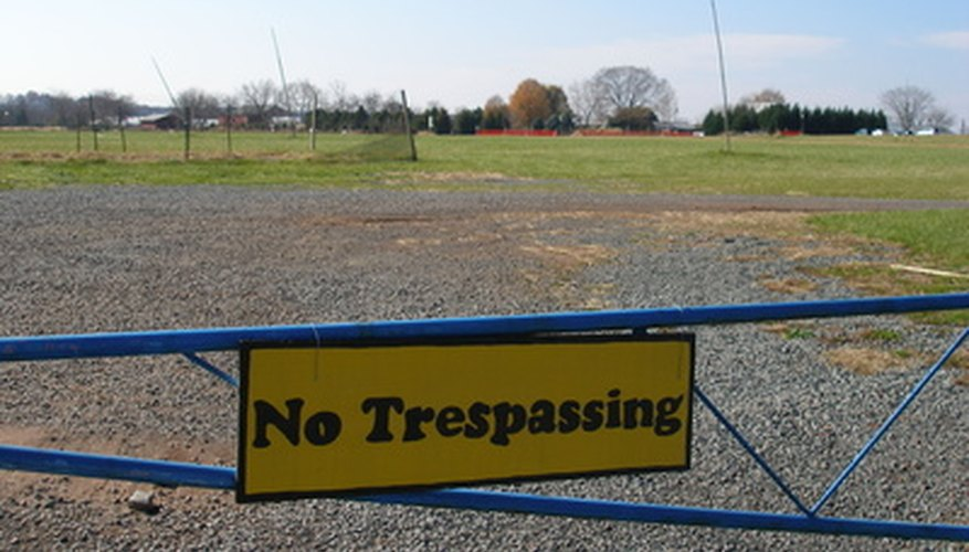 Driveways clearly become a no trespassing zone by posting appropriate signage.