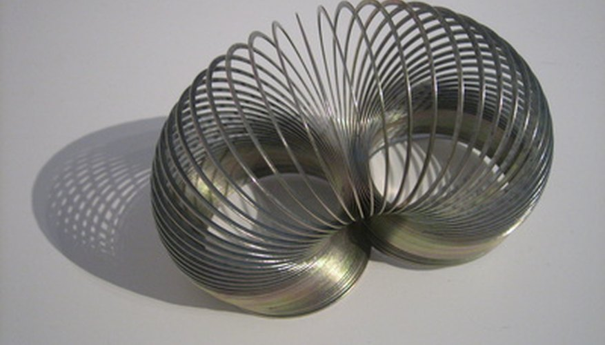 The tendency for a slinky to return to its natural shape makes it good for tricks.