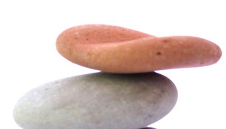 Traditional zen gardens utilize odd numbers of rocks as decorative elements.