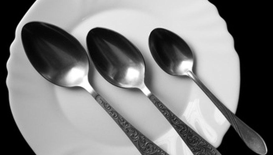 Sterling flatware includes silver spoons.
