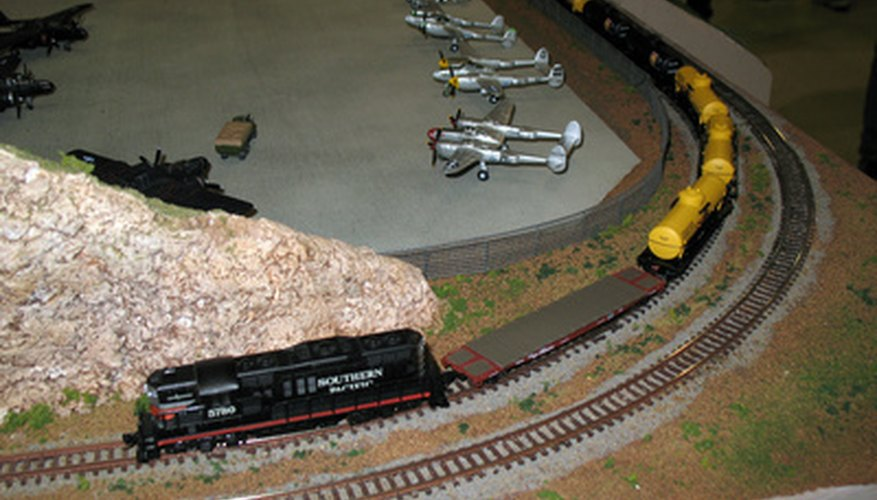 A local freight enters a curve on a small tabletop layout.