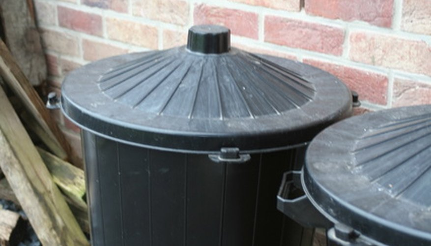 Trash cans can be used as rain barrels.