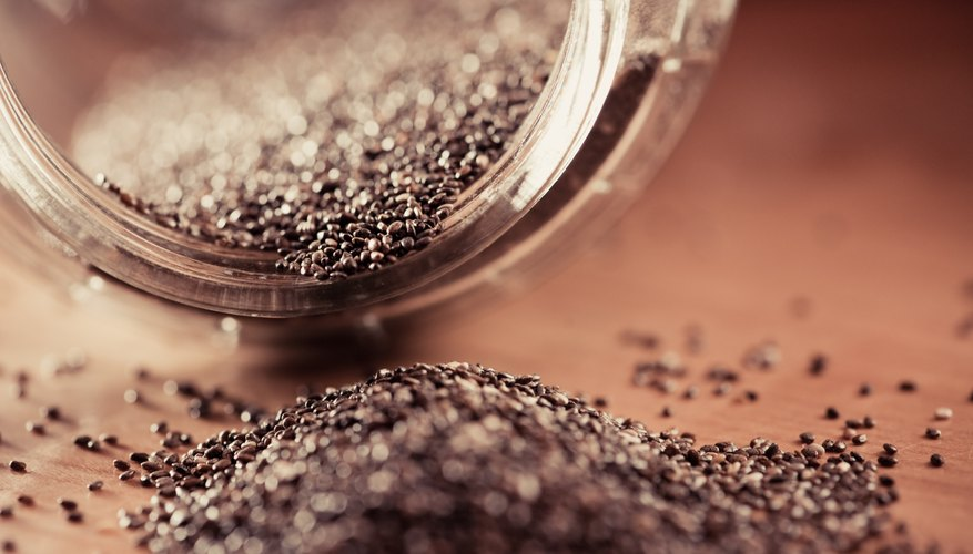 Chia seeds pouring out of jar