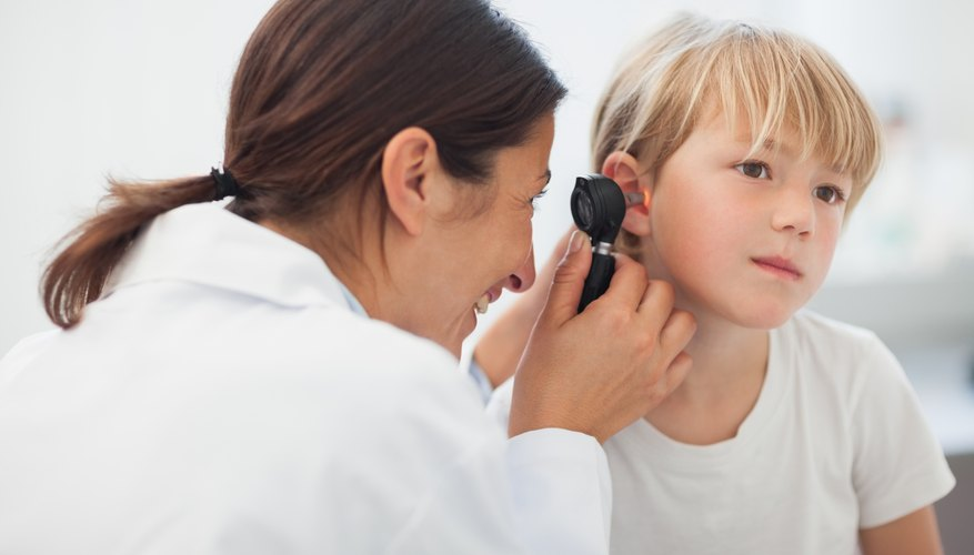 Doctor looking in patients ear