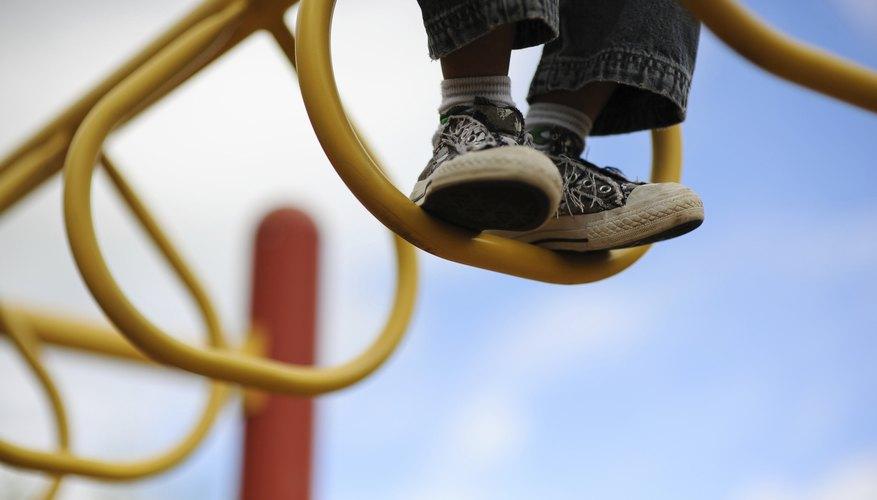 Child climbing on bars