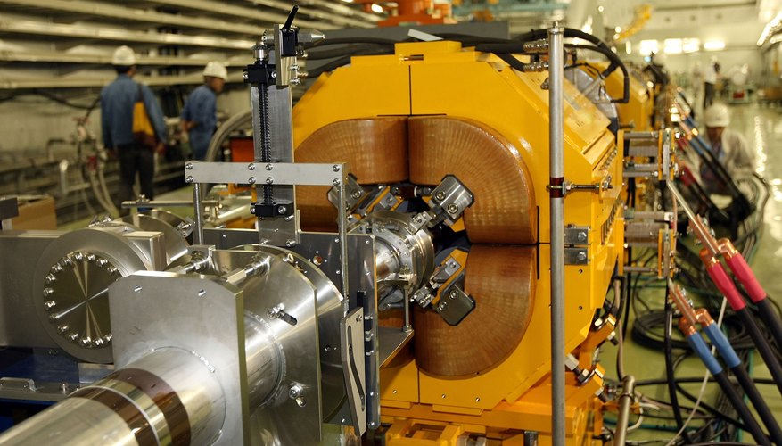 Men working with a Proton Synchrotron.