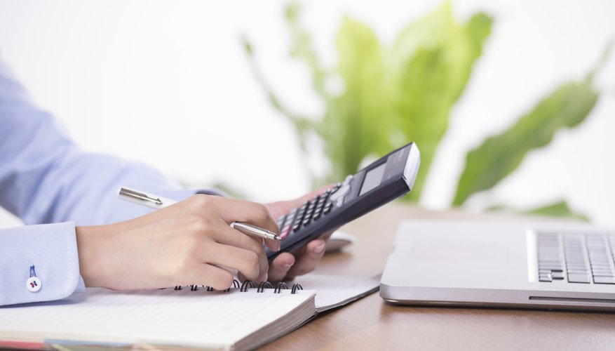 Close-up of working businesswoman - Stock Image