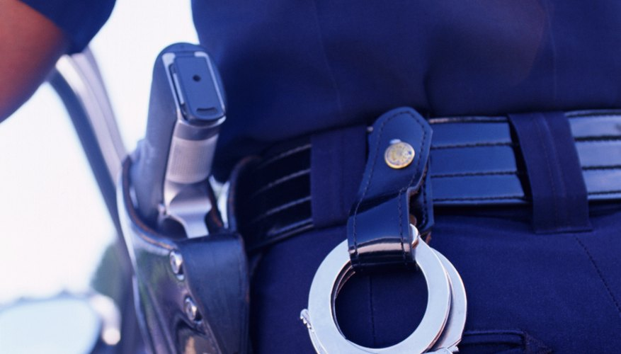 Police officers use belly chains with handcuffs to restrain prisoners.