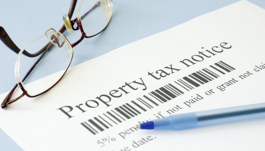A property tax notice with a pen on a table.