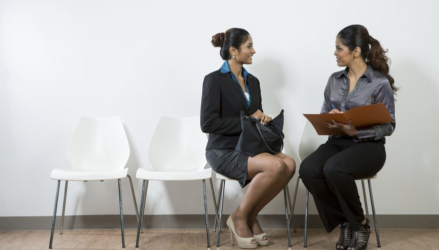 Indian woman from hr department interview a female applicant.