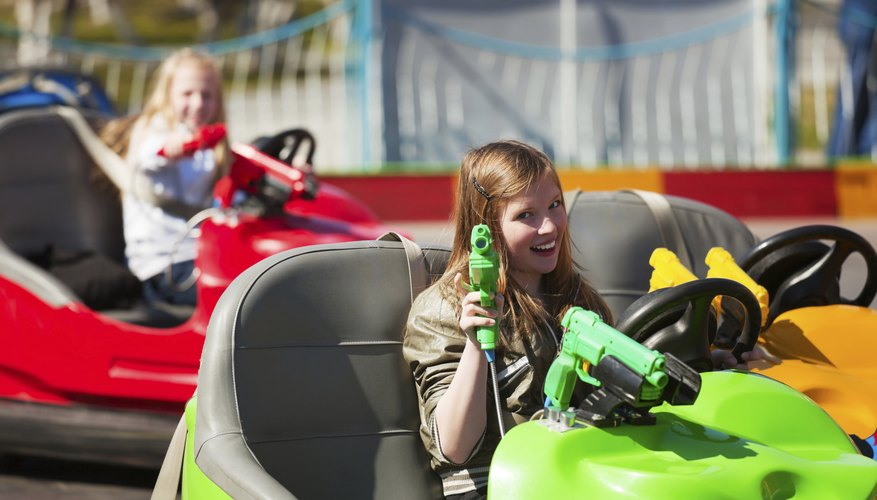 young girls in bumper cars