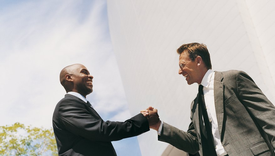 Businessmen Smiling and Shaking Hands
