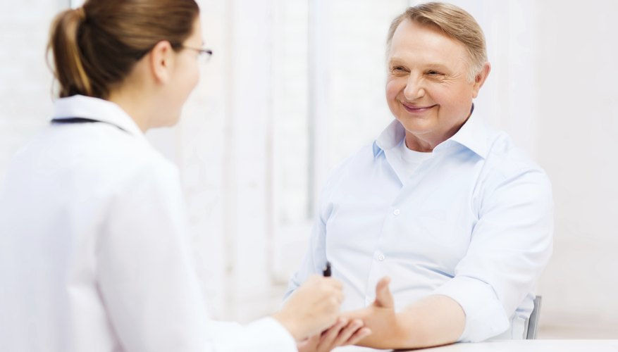 Senior patient talking to doctor in office.