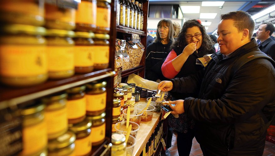 People sample olive oils inside market in Brooklyn, NY.
