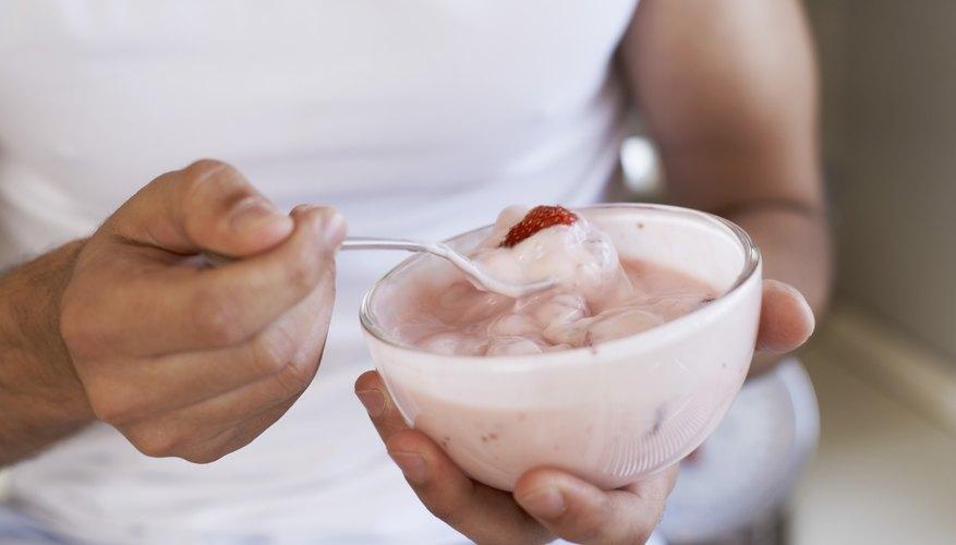 A woman eats a bowl of probiotic rich yogurt.