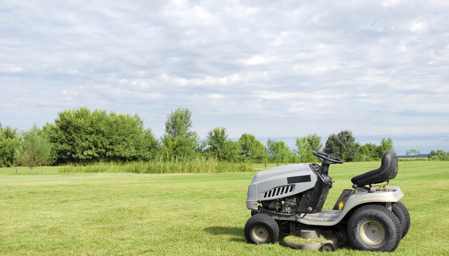 Lawn tractor parked in front of an open field