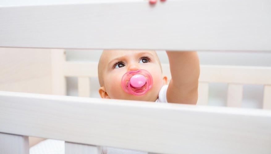 Baby reaching up in crib