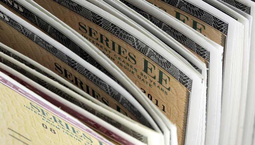 A close-up of a stack of U.S Treasury savings bonds.