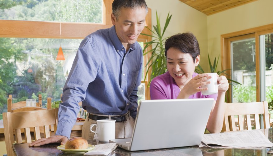Couple with laptop computer
