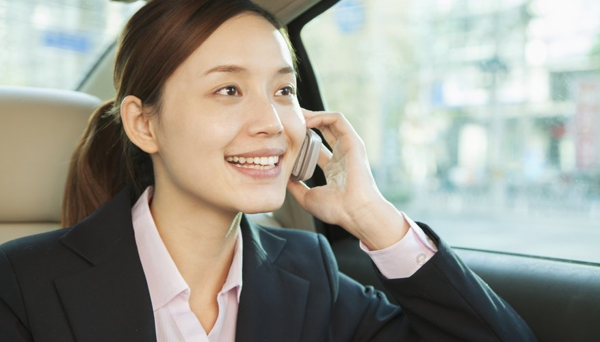 Businesswoman in Back Seat of Car on the Phone