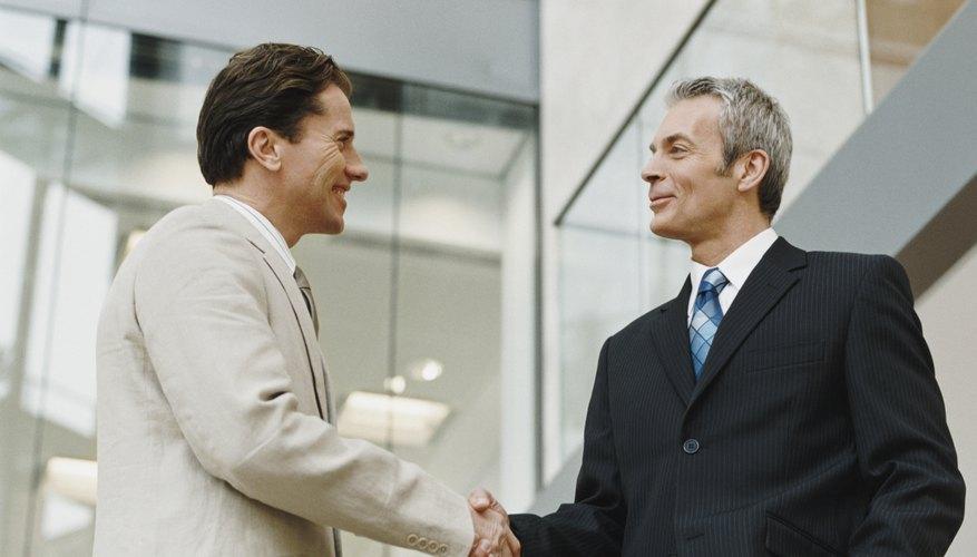 Two Mature Businessmen Shake Hands
