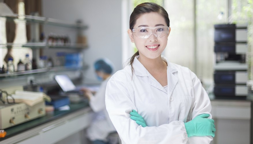 Smiling young chemist in laboratory