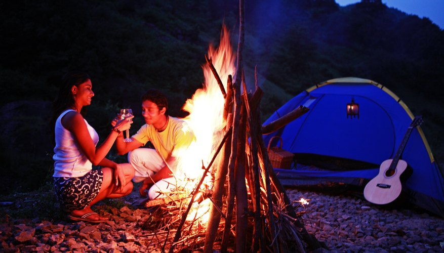 Turn a night time picnic into a romantic camp-out with an intimate partner.
