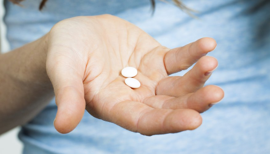 Close-up of hand holding pills